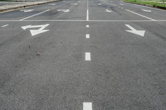 Asphalt road with arrow sign and white dot line Stock Photo