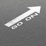 Asphalt Road Background with Signal Arrow and Word Go On Stock Photo