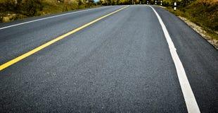 Asphalt road background. Transportation, highway Stock Images