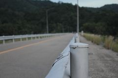 Asphalt road with barrier. Empty road on dam with barrier and pavement royalty free stock photos