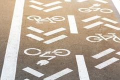 Asphalt road with bicycle and electric transport lane. Cycle and zero emission vehicles white sign on floor. Recreation area for g. Reen energy transport in city stock photo