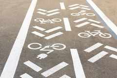 Asphalt road with bicycle and electric transport lane. Cycle and zero emission vehicles white sign on floor. Recreation area for g. Reen energy transport in city stock photography