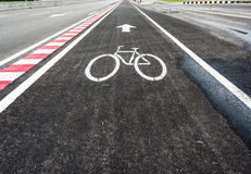 asphalt road and bike lane with sign Royalty Free Stock Photos