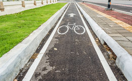 asphalt road and bike lane with sign Royalty Free Stock Image