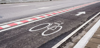 asphalt road and bike lane with sign Stock Images