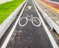 asphalt road and bike lane with sign Stock Photos