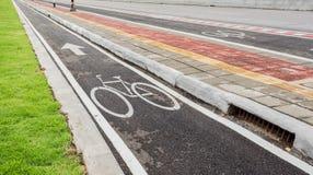 asphalt road and bike lane with sign Stock Image
