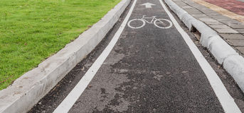 asphalt road and bike lane with sign Royalty Free Stock Photo