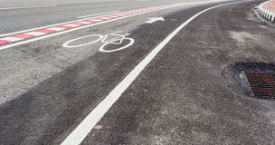 asphalt road and bike lane with sign Stock Photography