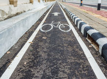 asphalt road and bike lane with sign Stock Photo