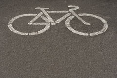 Asphalt road with bike sign. Stock Photo