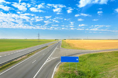 Asphalt road. Blank road sign - right turn Royalty Free Stock Images