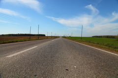 Asphalt road and blue sky Stock Images