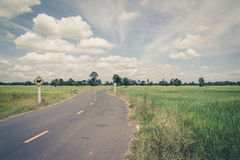Asphalt road and blue sky ,vintage Stock Image