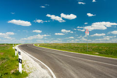 Asphalt Road With Blue Sky And White Clouds. Asphalt Road With Blue Sky And White Clouds In Sunny Day Stock Image