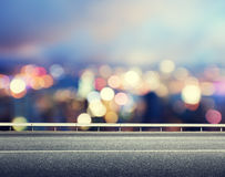 Asphalt road and blurred city Royalty Free Stock Photo