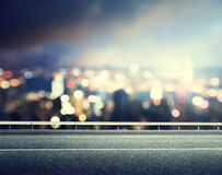 Asphalt road and blurred city Royalty Free Stock Photography