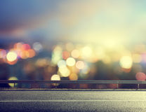 Asphalt road and blurred city Royalty Free Stock Photos