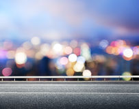 Asphalt road and blurred city Stock Photos