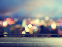 Asphalt road and blurred city Stock Photography