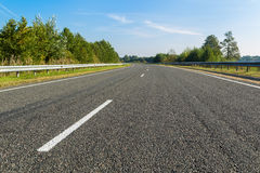 Asphalt Road without cars Stock Images