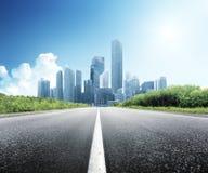 Asphalt road and city. Asphalt road and modern city