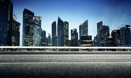 Asphalt road and city. Asphalt road and modern city Royalty Free Stock Photo