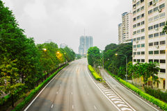 Asphalt road and a city in the morning. Stock Photos