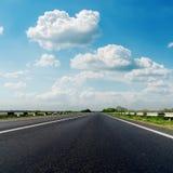 Asphalt road closeup and low clouds Stock Photo
