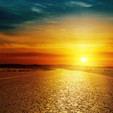 Asphalt road closeup and sunset Stock Photography