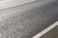 Asphalt road closeup Stock Images