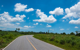 Asphalt road and clouds on blue sky. In May 30,2014 Stock Photography
