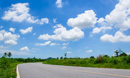 Asphalt road and clouds on blue sky. In May 30,2014 Royalty Free Stock Photo