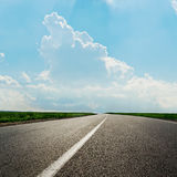 Asphalt road and clouds in blue sky Stock Photo