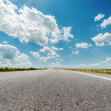 Asphalt road and clouds over it Royalty Free Stock Image