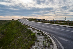 Asphalt road on a cloudy evening Royalty Free Stock Photography