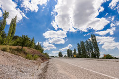 Asphalt road with cloudy sky Stock Photography