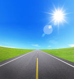 Asphalt road with cloudy sky and sunlight Stock Photo
