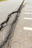 Asphalt road collapse. Royalty Free Stock Photo