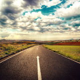 Asphalt road. Concept of straight way for business and new career start. Asphalt road over cloudscape background royalty free stock image