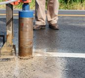 Asphaltic road coring. Asphalt road coring for evaluation field compaction Stock Images