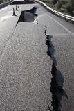 Asphalt road with a crack caused by landslides Royalty Free Stock Photo