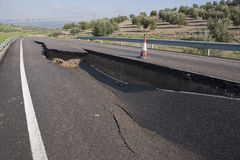 Asphalt road with a crack caused by landslides Royalty Free Stock Images