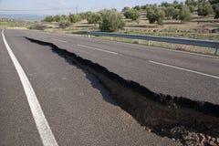 Asphalt road with a crack caused by landslides Stock Photo