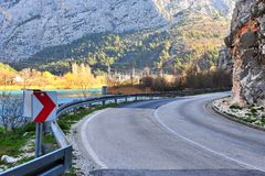 Asphalt road curve in mountains. Asphalt road curve in the mountains Royalty Free Stock Photos