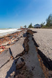 Asphalt road damaged. Asphalt roads damaged by sea waves stock photography