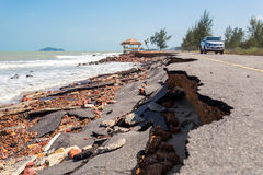 Asphalt road damaged. Asphalt roads damaged by sea waves royalty free stock image