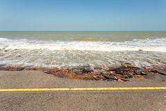 Asphalt road damaged. Asphalt roads damaged by sea waves stock images