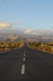 Asphalt Road dans le désert Photographie stock libre de droits