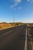 Asphalt Road dans le désert Photos stock